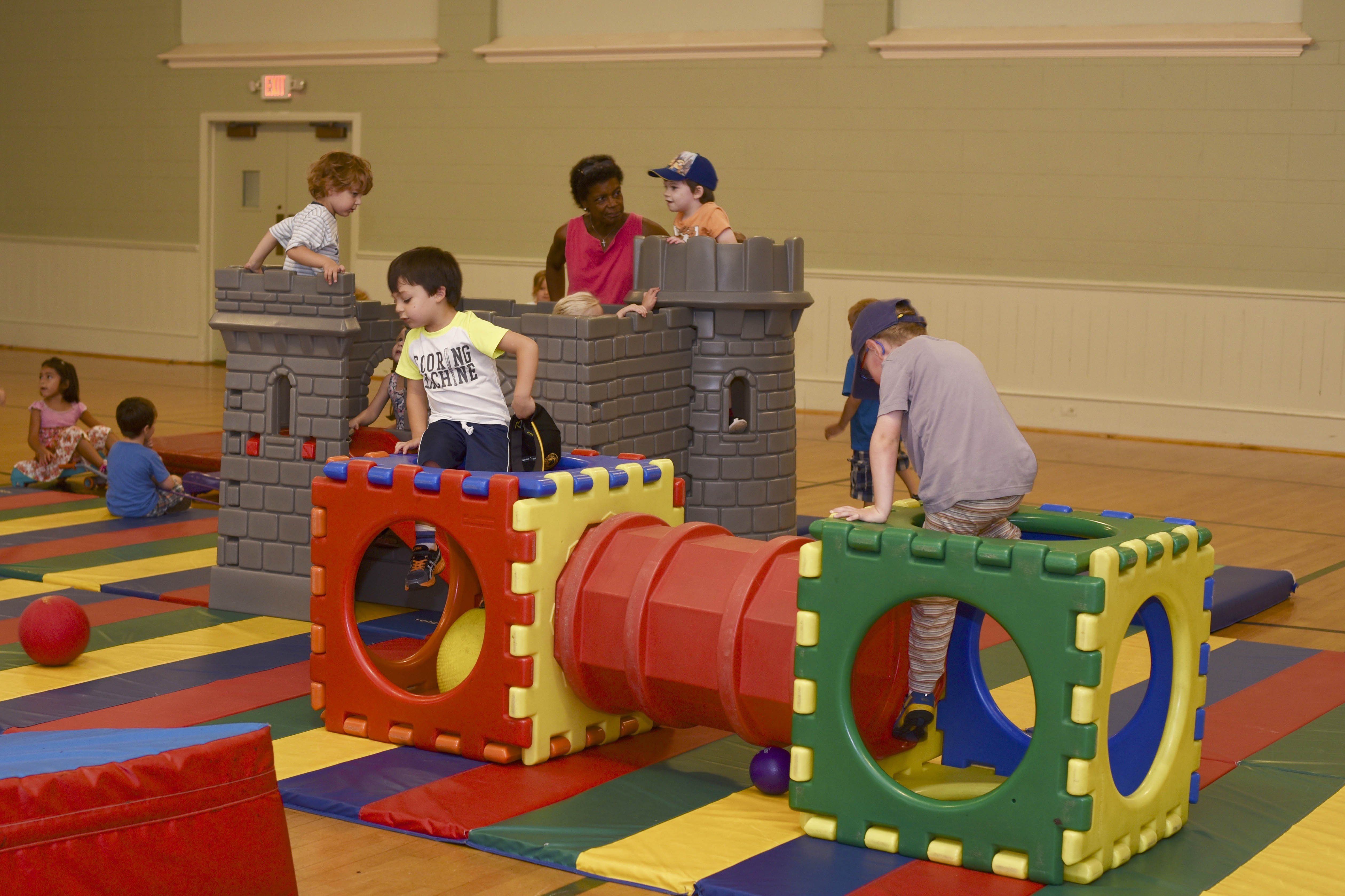Children climbing on castle structure in SLC Gym
