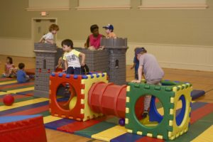 School for Little Children - children playing on castle in the gym